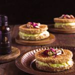 Rasmalai Frech Toast filled with Kesar Rabdi on a copper plate on a wooden table