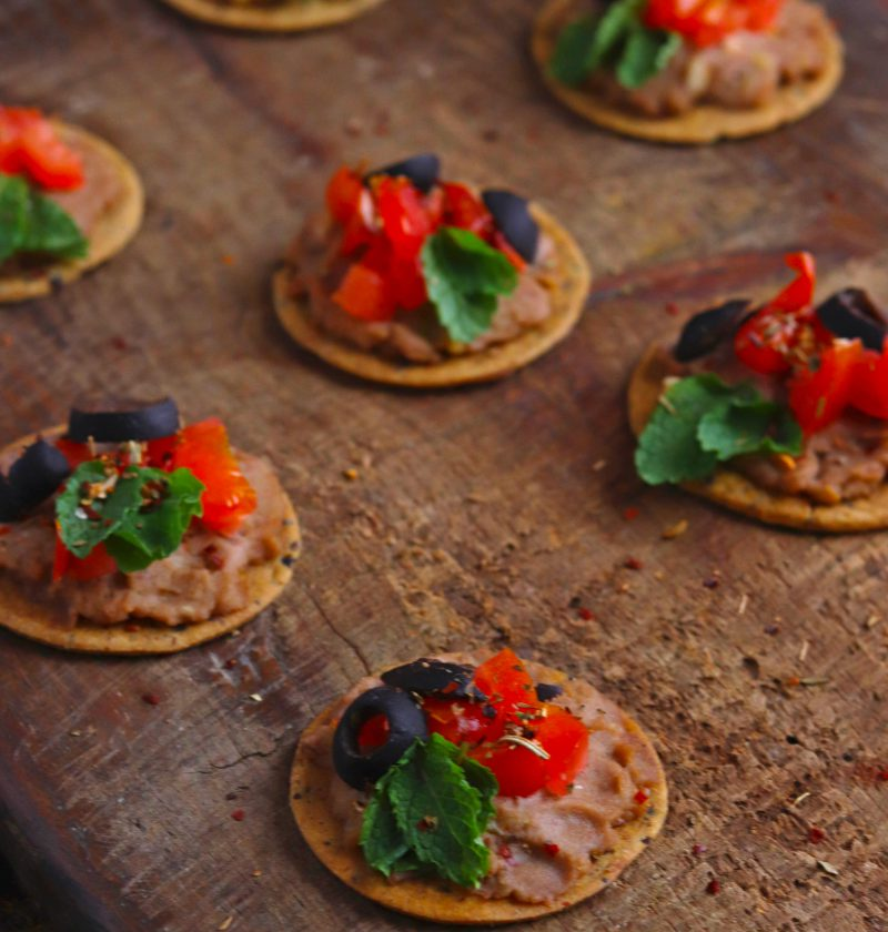 Veggie Hummus Crackers over a wooden platter