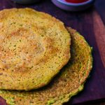 Matar Cheela Recipe on a wooden platter with green chutney and ketchup
