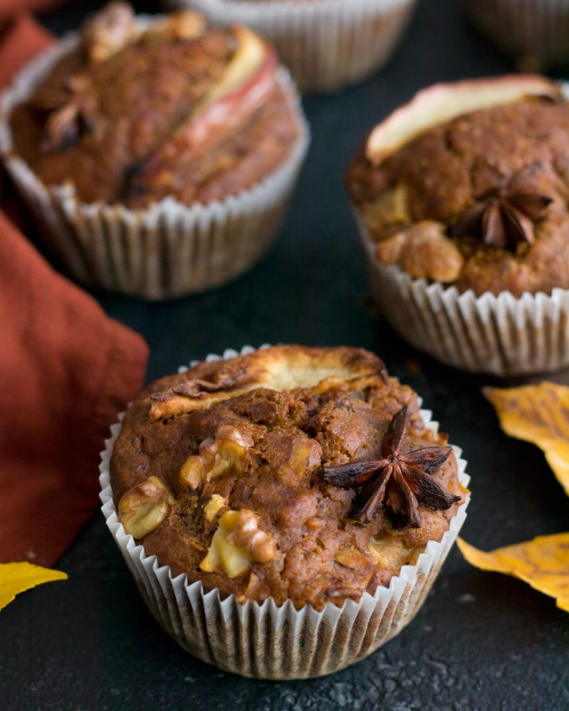 Eggless Apple Muffins over a black table